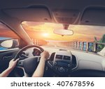 hands of a driver on steering... | Shutterstock . vector #407678596