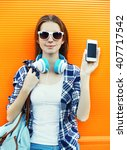 woman showing screen smartphone ... | Shutterstock . vector #407717542