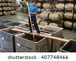 Small photo of Santa Maria, CA, USA; Oct 03, 2007; Hitching Post assistant winemaker Adele Swart punches down fermenting Pinot Noir wine grapes during the Hitching Post Winery wine harvest.