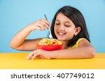 cute little indian asian girl... | Shutterstock . vector #407749012