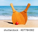 set for a game of beach tennis... | Shutterstock . vector #407784382