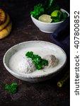 Small photo of Kibbeh bil laban - arabian yogurt soup with stuffed bulgur cutletson dark background. Selective focus