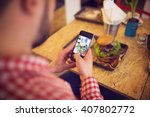 Small photo of Taking a pic of food for social network site
