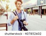 male tourist in city | Shutterstock . vector #407852602