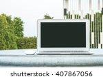 closeup computer on cement desk ... | Shutterstock . vector #407867056