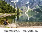 woman tourist in mountains at... | Shutterstock . vector #407908846