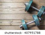 vintage dumbbells on the wooden ...   Shutterstock . vector #407951788
