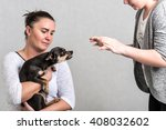 Small photo of Defending pinscher dog