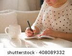 woman sitting at the table ... | Shutterstock . vector #408089332