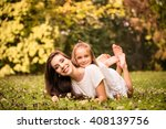 beautiful happy mother lying... | Shutterstock . vector #408139756