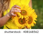 Young Girl Holding A Bouquet O...