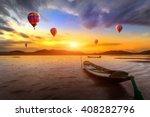 hot air balloon over sunset sea | Shutterstock . vector #408282796