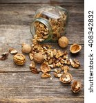 walnuts on rustic old wooden... | Shutterstock . vector #408342832