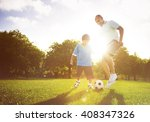 little boy playing soccer with... | Shutterstock . vector #408347326