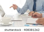 Small photo of Finance adviser analyze financial numbers to view the performance of the company for investment planning
