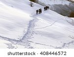 Hikers Walking On A Path In Th...