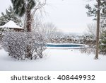 Snow Covered Backyard With Pool.