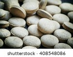 Small photo of Brewer's yeast tablets on a dark background, selective focus, shallow depth of field