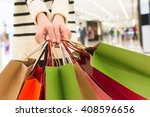 holding shopping bags in