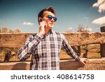 young man talking by phone in... | Shutterstock . vector #408614758