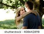 a young couple standing beneath ... | Shutterstock . vector #408642898