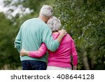 a senior couple standing with... | Shutterstock . vector #408644128