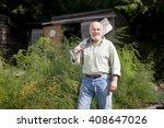 A Senior Man Holding A Spade O...