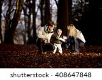 a child looking at a leaf with... | Shutterstock . vector #408647848