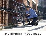 a businessman pumping up the... | Shutterstock . vector #408648112