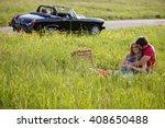 a young couple having a picnic... | Shutterstock . vector #408650488