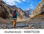 girl with a big backpack is... | Shutterstock . vector #408870238