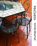 wet chairs and table