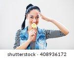 happy girl with lollipop is... | Shutterstock . vector #408936172