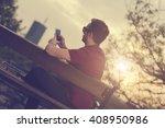 modern guy using cellphone... | Shutterstock . vector #408950986
