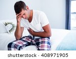 Young Man Sitting With Stomach...