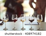 many glasses of different wine... | Shutterstock . vector #408974182