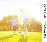 little boy playing soccer with... | Shutterstock . vector #409008952