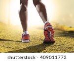 close up feet with running... | Shutterstock . vector #409011772
