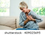senior woman suffering from... | Shutterstock . vector #409025695