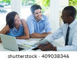 Small photo of Couple and real estate agent discussing together at home