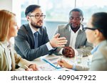Small photo of Young manager expressing his ideas at meeting