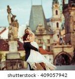 romantic strong newlywed groom... | Shutterstock . vector #409057942