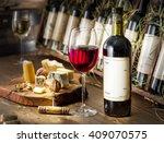 Wine Bottles On The Wooden...