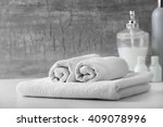 white towels with liquid soap...   Shutterstock . vector #409078996