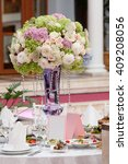 table setting at a luxury... | Shutterstock . vector #409208056