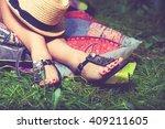 woman feet on grass in flat... | Shutterstock . vector #409211605