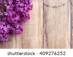 Lilac Flowers On A Old Wooden...