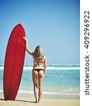 beautiful young surfer girl on... | Shutterstock . vector #409296922