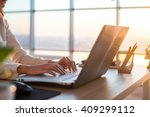 adult businesswoman working at... | Shutterstock . vector #409299112