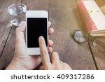 lady hand surfing internet on... | Shutterstock . vector #409317286